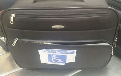 The suitcase in which rare Uzbek pigeons were hidden, during a smuggling attempt thwarted at Ben Gurion Airport. The bag had a disabled luggage tag in order to avoid suspicion. (Agriculture Ministry)