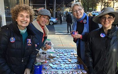 Karen Terban (left) and her fellow Hillary activists hawking Hillary pins on an Upper West Side sidewalk on Monday afternoon, November 7, 2016 (Jessica Steinberg/Times of Israel)