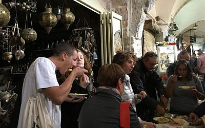 Chowing down on maklouba and hummus with Open Restaurants at the Old City market (Jessica Steinberg/Times of Israel)