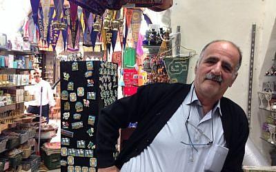 Shaban R in his souvenir shop on Christian Quarter road on November 9, 2016 (Tamar Pileggi/Times of Israel)