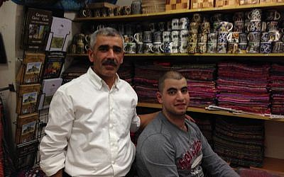 Nidal and his son (unnamed) in his shop on Christian Quarter Road in the Old City of Jerusalem on November 9, 2016 (Tamar Pileggi/Times of Israel)