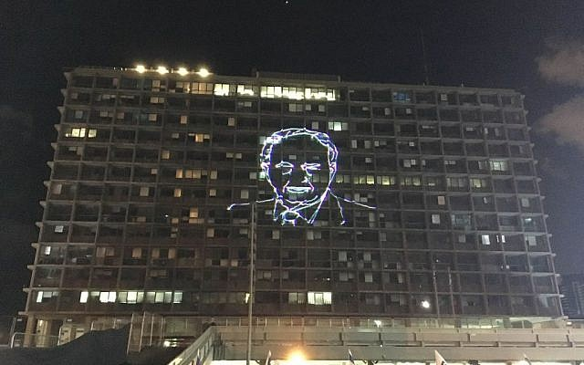 A portrait of Yitzhak Rabin light up the municipal building in Tel Aviv as tens of thousands gather in Rabin Square to mark the 21st anniversary of the prime minister's assassination on November 5, 2016 (Iacopo Luzi)