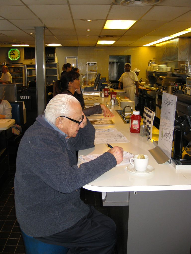 Hymie Sckolnick seated at Beauty's. Other than family events, this is where his great-grandchildren come to find him. (Steve North)