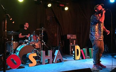Kosha Dillz performing onstage at the Satellite in Los Angeles. (Madison Margolin/Times of Israel)