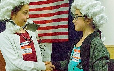 Jessica,8, and Molly, 8, both on the Thomas Jefferson team, congratulate each other on a job well done. (Michael Fried)