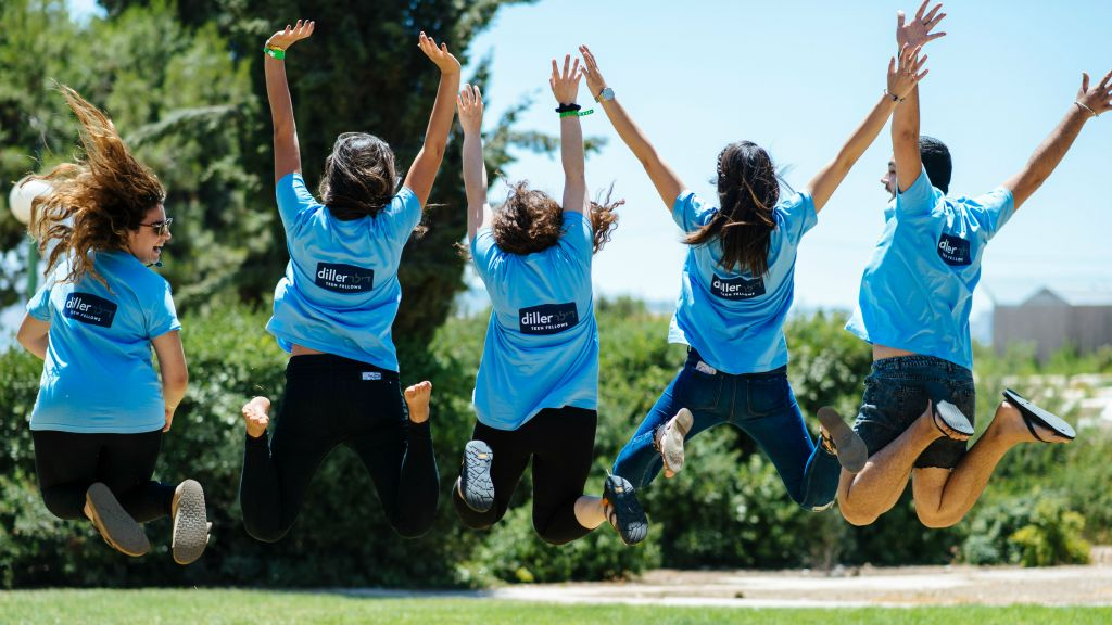 Diller Teen Fellows jump for joy during their summer conference in Israel. (courtesy)
