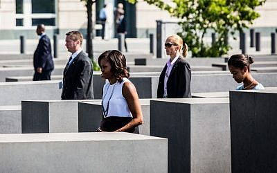 First lady Michelle Obama and daughter Malia visiting the Holocaust memorial in Berlin, June 19, 2013. (Marco Priske / Stiftung Denkmal via JTA)