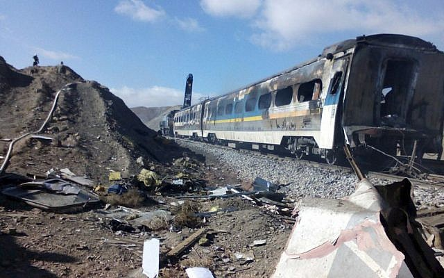 This picture released by Iranian Fars News Agency shows the scene of two trains collision about 150 miles (250 kilometers) east of the capital Tehran, Iran, Friday, Nov. 25, 2016. (Saeed Esmaeilpour, Fars News Agency via AP)