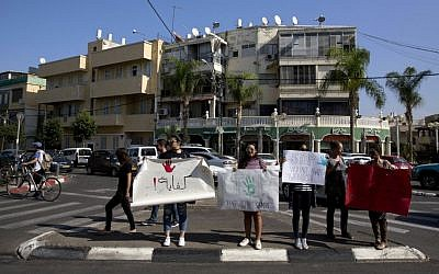 "Israeli Arab women hold signs during a demonstration in Jaffa, Israel, Arabic sign on the left reads: ""Enough"" after a string of murders of Israeli-Arab women by suspected relatives, Friday, Oct. 28, 2016. (AP Photo/Sebastian Scheiner)"