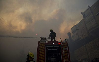 Firefighters fight wildfires in Haifa, Israel, Thursday, Nov. 24, 2016. (AP Photo/Ariel Schalit)
