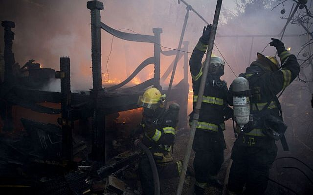 Firefighters work in a home in Haifa, Israel, Thursday, November 24, 2016. (AP Photo/Ariel Schalit)