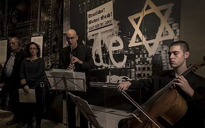 Israeli musicians perform at the Yad Vashem Holocaust Memorial in Jerusalem in a somber tribute to the works of musicians who created a vibrant cultural life in the Terezin concentration camp before being sent to their deaths. Monday, Nov. 21, 2016 (AP Photo/Tsafrir Abayov)