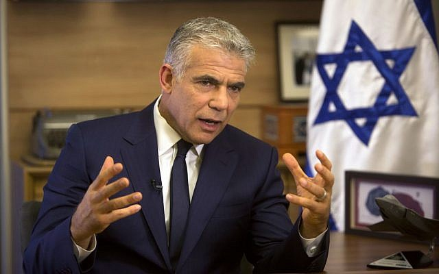 Monday, Oct. 31, 2016 photo, Israeli Knesset member, Yair Lapid, leader of the Yesh Atid party, spoke during an interview with The Associated Press, in his office at the Knesset, Israel's parliament, in Jerusalem. (AP Photo/Sebastian Scheiner)