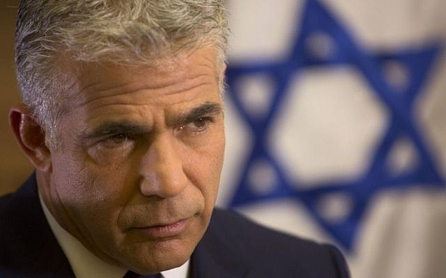 Yair Lapid, leader of the Yesh Atid party, in his office at the Knesset (AP Photo/Sebastian Scheiner)