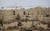Construction cranes in the neighborhood of Gilo in East Jerusalem, January 16, 2011. (AP Photo/Sebastian Scheiner, file)