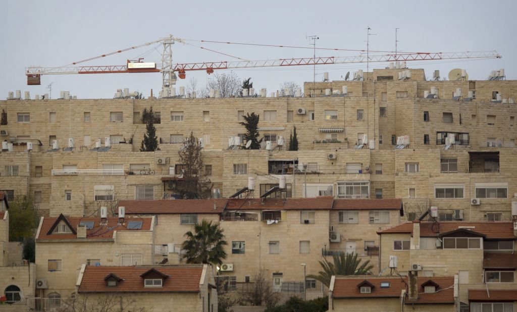 Construction cranes in the Jewish neighborhood of Gilo in East Jerusalem, January 16, 2011. (AP Photo/Sebastian Scheiner, file)