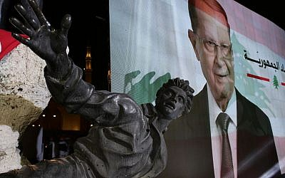 "A giant picture of the newly-elected Lebanese President Michel Aoun is seen behind the Statue of Martyrs created by Italian artist Marino Mazzacurati, during a rally at Martyrs Square in downtown Beirut, Lebanon, Monday, Oct. 31, 2016. Lebanon's parliament on Monday elected Michel Aoun, an 81-year-old former army commander and strong ally of the militant group Hezbollah, as the country's president, ending a more than two-year vacuum in the top post and a political crisis that brought state institutions perilously close to collapse. Arabic on the picture reads ""Republic"". (AP Photo/Hassan Ammar)"