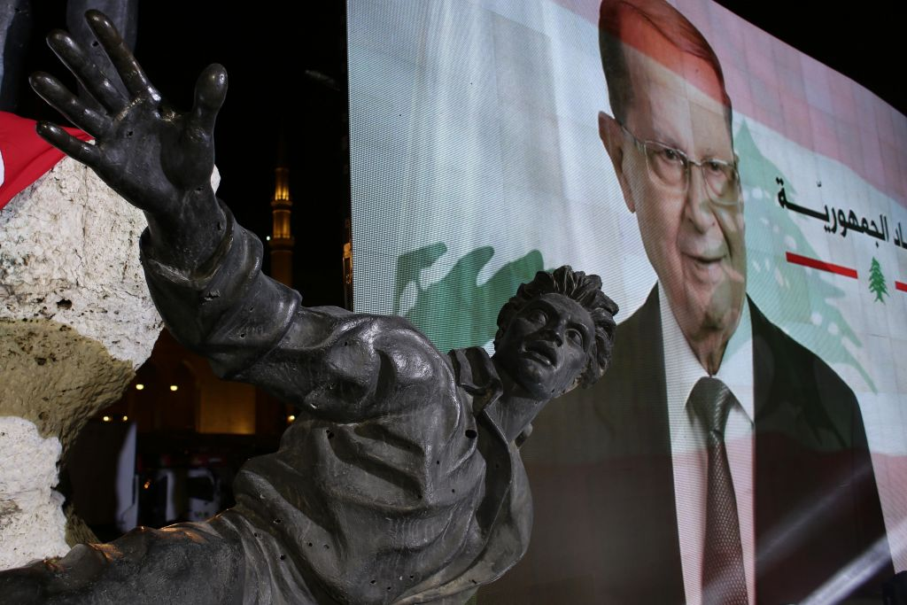 A giant picture of the then newly-elected Lebanese President Michel Aoun, behind the Statue of Martyrs created by Italian artist Marino Mazzacurati, during a rally at Martyrs Square in downtown Beirut, Lebanon, October 31, 2016. (AP Photo/Hassan Ammar)