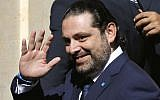 Lebanese Prime Minister Saad Hariri waves to journalists, shown before his election upon his arrival to the parliament building in Beirut, Lebanon, October 31, 2016. (AP Photo/Hussein Malla)