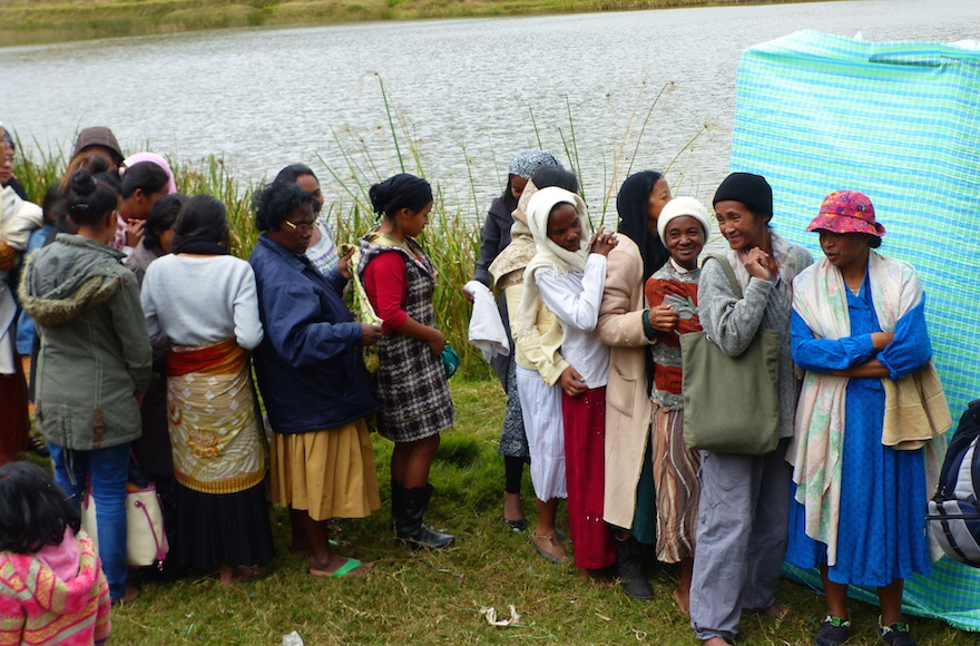 Malagasy women getting ready to immerse in the river before converting to Judaism, near Antananarivo, Madagascar, May 2016. (Deborah Josefson/JTA)