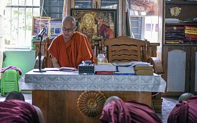 In this Nov. 12, 2016 photo, Wirathu, a high-profile leader of the Myanmar Buddhist organization known as Ma Ba Tha, teaches some younger novice monks at his monastery in Mandalay, Myanmar. (AP/Aung Naing Soe)