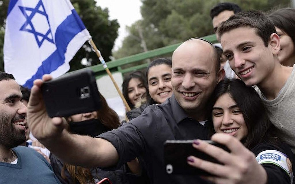 Education Minister Naftali Bennett taking selfies with students at Bleich High School in the central Israeli city of Ramat Gan, Feb. 12, 2015. (Tomer Neuberg/Flash90)