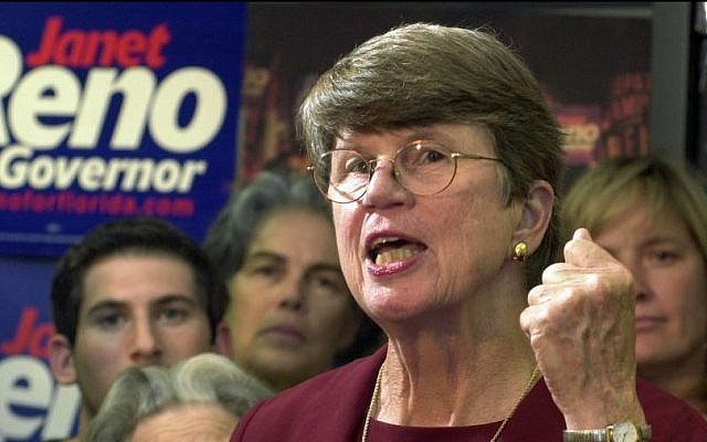 """Democratic gubernatorial candidate Janet Reno gestures during her concession speech at her Miami Lakes, Fla., campaign headquarters saying she told Bill McBride """"he was going to be a great governor."""" September 17, 2002. (AP Photo/Marta Lavandier)"""