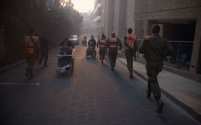 Troops from the IDF's Home Front Command assist in evacuations in Haifa in light of a massive fire in parts of the city on November 24, 2016. (IDF Spokesperson's Unit)