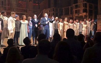 In this image made from a video provided by Hamilton LLC, actor Brandon Victor Dixon who plays Aaron Burr, the nation's third vice president, in 'Hamilton' speaks from the stage after the curtain call in New York, Friday, Nov. 18, 2016. (Hamilton LLC via AP)