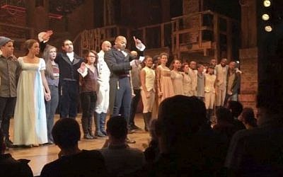"In this image made from a video provided by Hamilton LLC, actor Brandon Victor Dixon, who plays Aaron Burr, the nation's third vice president, in ""Hamilton,"" speaks from the stage after the curtain call in New York, Friday, Nov. 18, 2016. (Hamilton LLC via AP)"