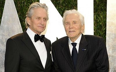 In this Feb. 26, 2012 file photo, Michael Douglas, left, and Kirk Douglas arrive at the Vanity Fair Oscar party in West Hollywood, California. (AP Photo/Evan Agostini, File)