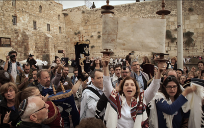 Anat Hoffman, director of Women of the Wall, holds a Torah scroll at the Western Wall, November 2, 2016. (Luke Tress/Times of Israel)