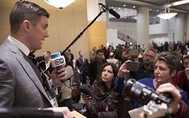 In this Nov. 18, 2016, photo, Richard Spencer, left, talks to the media at an Alt Right conference hosted by the National Policy Institute in Washington. (Linda Davidson/The Washington Post via AP)