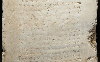 This undated photo provided by Heritage Auctions, HA.com shows the world's earliest-known stone inscription of the Ten Commandments – a two-foot square slab of white marble, weighing about 115 pounds and inscribed in an early Hebrew script called Samaritan, that sold for $850,000 Wednesday evening, Nov. 16, 2016, (Matt Roppolo/Heritage Auctions, HA.com via AP)