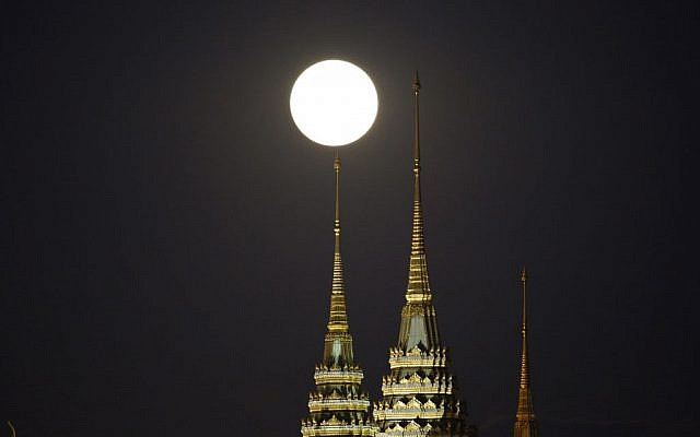 The brightest moon in almost 69 years rises over the Grand Palace in Bangkok, Thailand Monday, Nov. 14, 2016. (Sakchai Lalit/AP Photo)