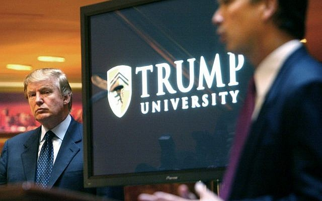 In this May 23, 2005 file photo, then real estate mogul and Reality TV star Donald Trump, left, listens as Michael Sexton introduces him at a news conference in New York where he announced the establishment of Trump University. (AP Photo/Bebeto Matthews, File)