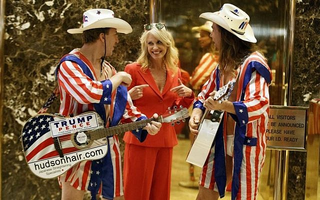 Kellyanne Conway, campaign manager for President-elect Donald Trump, center, listens to a song by 'The Naked Cowboy,' in the lobby of Trump Tower, in New York, November 28, 2016. (AP/Evan Vucci)