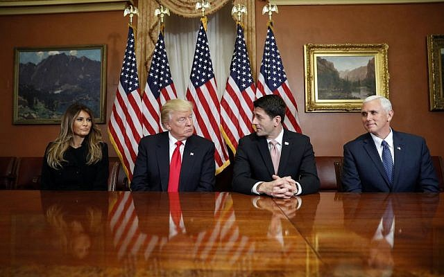President-elect Donald Trump, his wife Melania and Vice president-elect Mike Pence, pose for photographers with House Speaker Paul Ryan of Wis. after a meeting in the Speaker's office on Capitol Hill in Washington, Thursday, Nov. 10, 2016. (AP Photo/Alex Brandon)