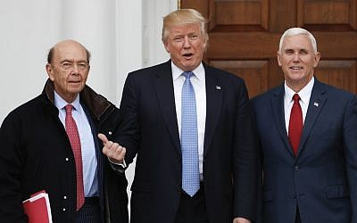 President-elect Donald Trump, center, and Vice President-elect Mike Pence, right, pose with investor Wilbur Ross at the Trump National Golf Club Bedminster clubhouse, November 20, 2016, in Bedminster, N.J.. (AP Photo/Carolyn Kaster)