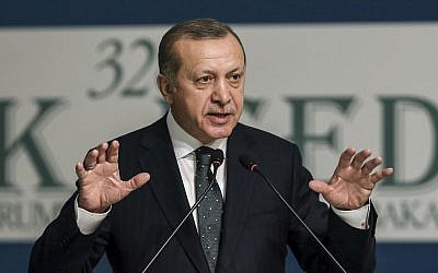 Turkey's President Recep Tayyip Erdogan addresses an annual economy and trade meeting of the Organization for Islamic Cooperation in Istanbul, Wednesday, Nov. 23, 2016. (Yasin Bulbul, Presidential Press Service/Pool Photo via AP)