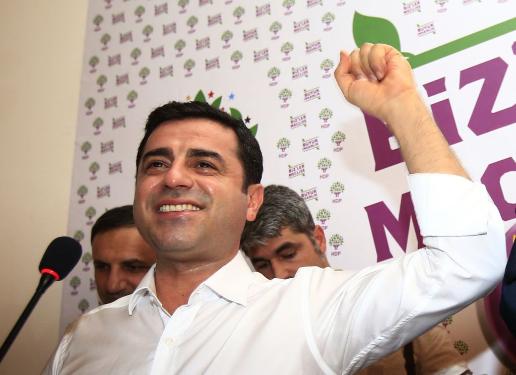 In this Sunday, June 7, 2015 file photo, Selahattin Demirtas, co-chair of the pro-Kurdish Peoples' Democratic Party, (HDP) celebrates following a news conference in Istanbul, regarding their party's success at the elections. Authorities in Turkey detained 11 pro-Kurdish lawmakers early Friday, Nov. 4, 2016 as part of ongoing terror-related investigations, including Demirtas, Yuksekdag and other senior officials, the Interior Ministry said. (AP Photo/Lefteris Pitarakis, File)
