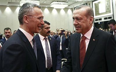 Turkey's President Recep Tayyip Erdogan, right, and NATO Secretary General Jens Stoltenberg shake hands as they attend a NATO parliamentary assembly meeting in Istanbul, Monday, Nov. 21, 2016. (Kayhan Ozer, Presidential Press Service, Pool photo via AP)