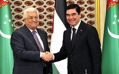 Turkmenistan's President Gurbanguli Berdymukhamedov, right, shakes hands with visiting Palestinian President Mahmoud Abbas in Ashgabat, Turkmenistan, on Monday, Nov. 14, 2016. (AP Photo/Alexander Vershinin)