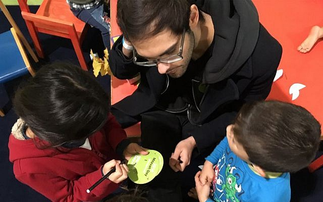 Yacob Yanai, an Israeli living in Berlin, volunteers with refugee children at the Spandau refugee shelter. November 13, 2016. (Courtesy)
