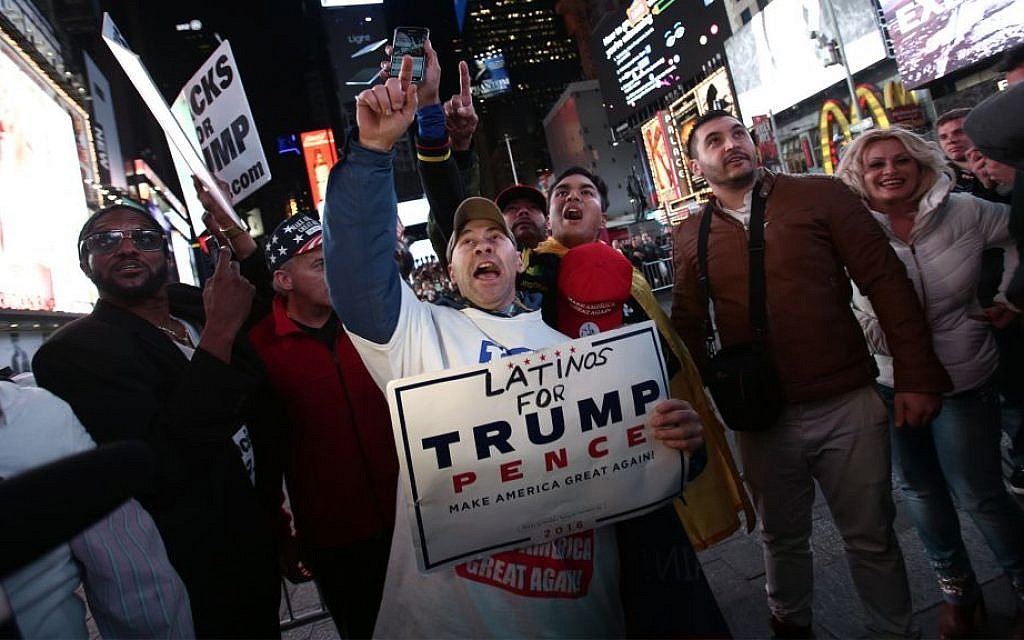 Dondald Trump supporters demonstrate as they watch election results in Times Square in New York City on November 8, 2016. (Noam Revkin FentonFlash90)