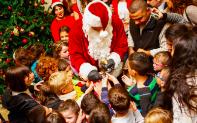 Handing out chocolates at the YMCA tree trimming in November 2015 (Courtesy YMCA)