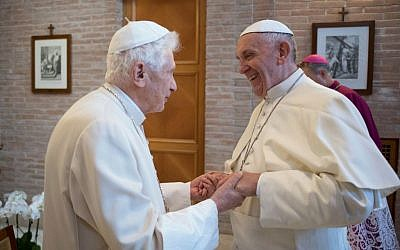 Pope Francis, right, talks with Pope Emeritus Benedict XVI in the former Convent Mater Ecclesiae at the Vatican, Saturday, Nov. 19, 2016. (L'Osservatore Romano/pool photo via AP)