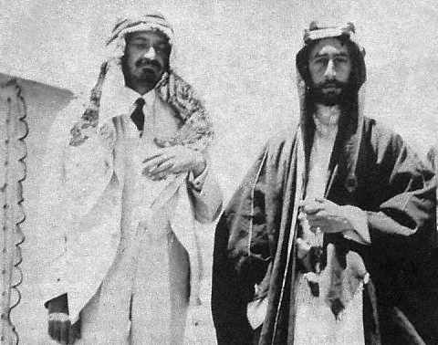 Chaim Weizmann (left), and Prince Faisal in Transjordan, June, 1918. Weizmann is wearing Arab dress as a sign of friendship. (Public domain)
