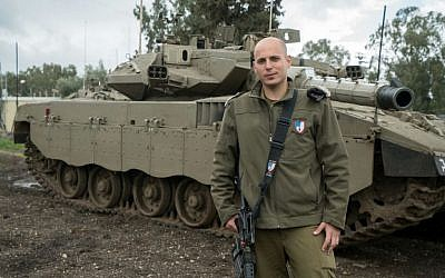 Then-Cpt. Yaakov Selavan stands in front of a tank in an undated photograph. (Courtesy Yaakov Selavan)