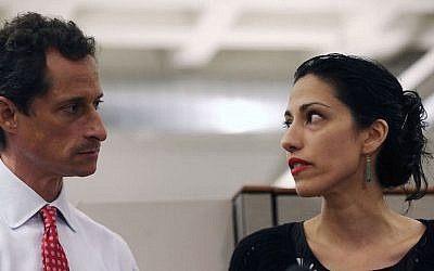 Anthony Weiner and Huma Abedin at a news conference in New York City at which Weiner acknowledged that he engaged in lewd online conversations with a woman after his resignation from Congress, July 23, 2013. (John Moore/Getty Images via JTA)